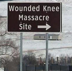 Roadsign points to the Wounded Knee Massacre Site