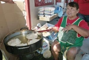 Indian woman makes fry bread